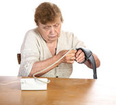 The old woman measures arterial pressure upon — Stock Photo