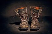 Old worn soldiers work boots — Stock Photo