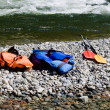 Stock Photo: Two life-jackets and two paddles