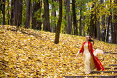 Lady in autumn forest — Stock Photo