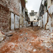 Street with ruins of demolished houses. Chennai, India - Stock Photo
