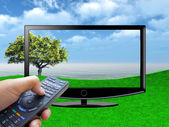 Watch tv concept with hand — Stock Photo