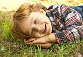 Portrait of a little smiling blond boy — Stock Photo