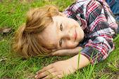 Portrait of a little smiling blond boy — Stock Photo