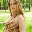 Stock Photo: Beautiful pregnant womlying on grass