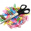 Colored paper clips and scissors — Stock Photo
