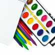 Paintbox, crayons and note book — Stock Photo