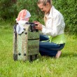 Girl and child in valise — Stock Photo