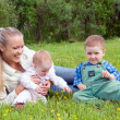 Mother with children on meadow — Stock Photo