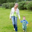 Younger ma with son on walk — Stock Photo