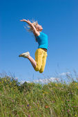 Young woman jumping — Stock Photo