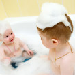 Bathing child..Small child in bath - Stock Photo