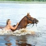 Girl bathe horse in a river — Stock Photo #2812375