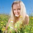 Sexy blonde on background meadow — Stock Photo