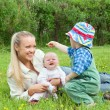 Mother with children on meadow — Stock Photo #2812393