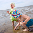 Stock Photo: Kids playing at the beach
