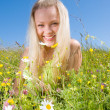 Stock Photo: Blonde on meadow with camomile