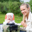 Younger woman and child in valise — Stock Photo