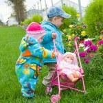 Children play on green herb — Stock Photo #2868766