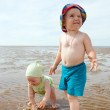 Kids playing at the beach  Sea — Foto Stock