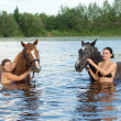 Young girl bathe horse — Stock Photo