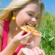 Nice girl eats pizza. lunch — Stock Photo