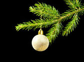 Christmas tree ornaments on dark — Stock Photo