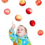 Baby girl caughts apple — Stock Photo
