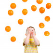 Child eats vented orange — Stock Photo #2925139