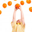 Child eats vented orange — Stock Photo