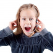 Stock Photo: Shocked little girl with headset.