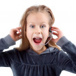 Shocked little girl with headset. - Stock Photo