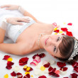 Bride  on  floor among red rose p — Stock Photo