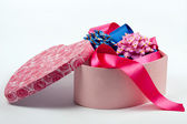 Gift box in the form of heart with bows. — Stock Photo