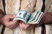 Sheaf of dollars in hands of the man — Stock Photo