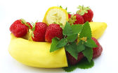 Banana with berries — Stock Photo
