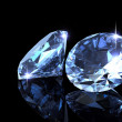 Two diamond on the black background - Stock Photo
