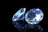 Two diamond on the black background — Stock Photo
