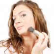 Woman putting make up — Stock fotografie