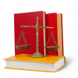 Stock Photo: Scales of justice atop legal books