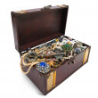Treasure chest with valuables and key — Stock Photo