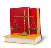 Scales of justice atop legal books — Stock Photo