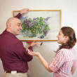 Couple and art picture — Stock Photo