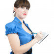Businesswoman writing on a notebook — Stockfoto