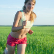 Girl in red running on meadow — Stock Photo