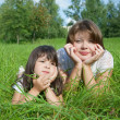 Mother with daughter on meadow - Stock Photo