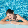 Girl in resort swimming pool — Stock Photo