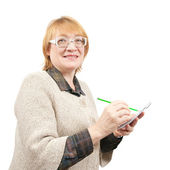 Senior woman writing on a papers — Stock Photo