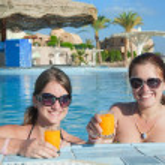Girls with orange juice — Stock Photo #2719308