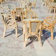 Cafe table and wicker chairs - Stock Photo